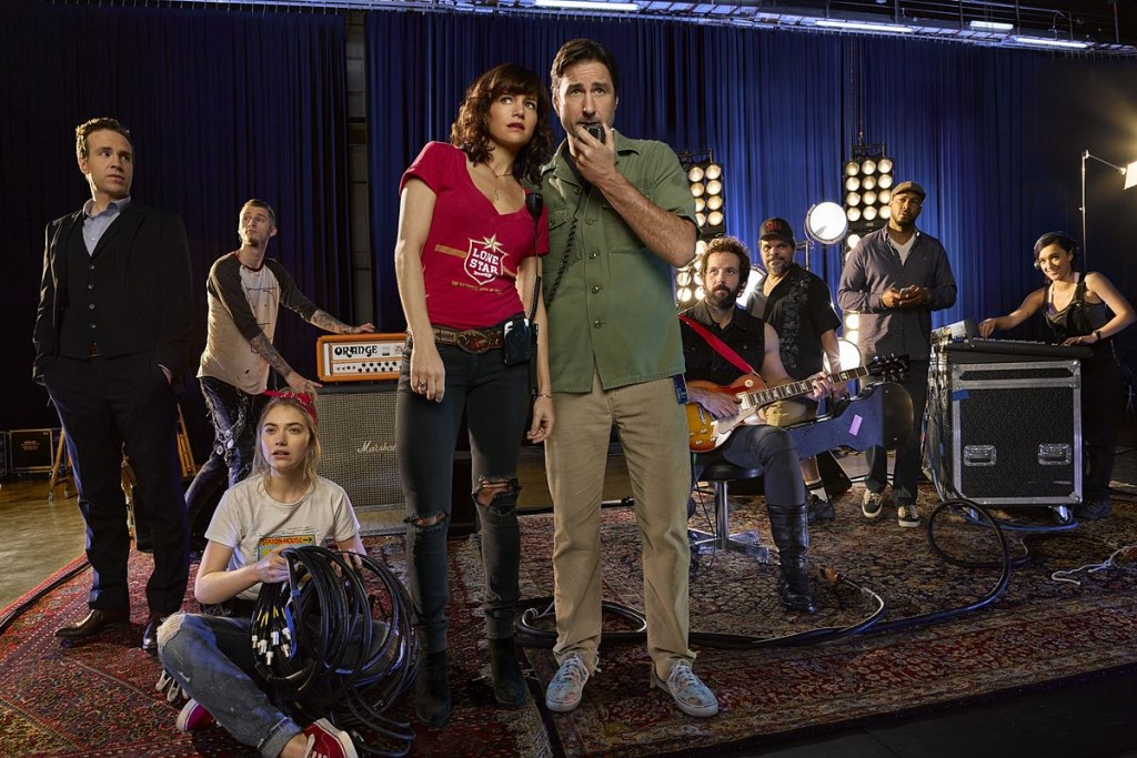Rafe Spall as Reg, Colson Baker as Wes, Imogen Poots as Kelly Ann, Carla Gugino as Shelli Anderson, Luke Wilson as Bill Hanson, Peter Cambor as Milo, Luis Guzman as Gooch, Finesse Mitchell as Harvey and Keisha Castle-Hughes as Donna in Roadies. Photo: Courtesy of SHOWTIME